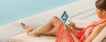 Woman at swimming pool with tablet